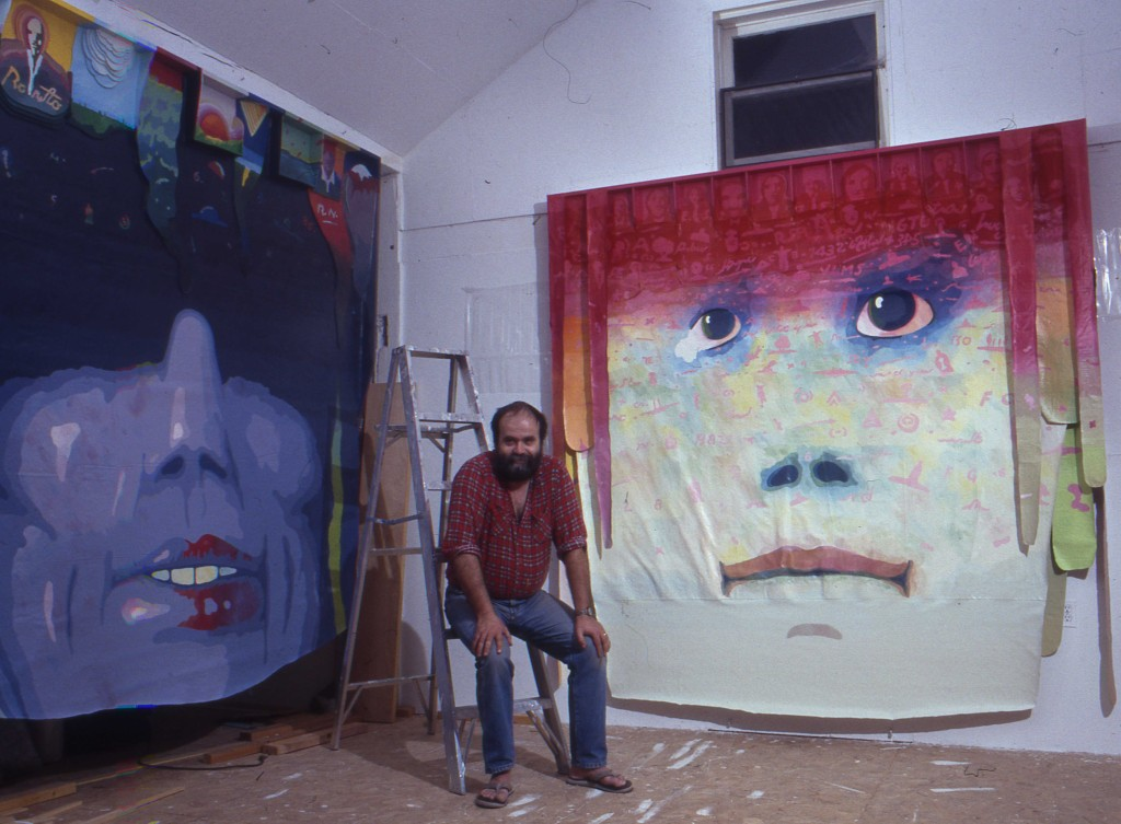 Jan Sawka in studio with banner paintings.
