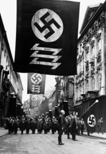 High impact graphics, including banners, were consistently used during the Third Reich during ceremonies and throughout the everyday landscape as well, serving as visual reinforcements of the system.